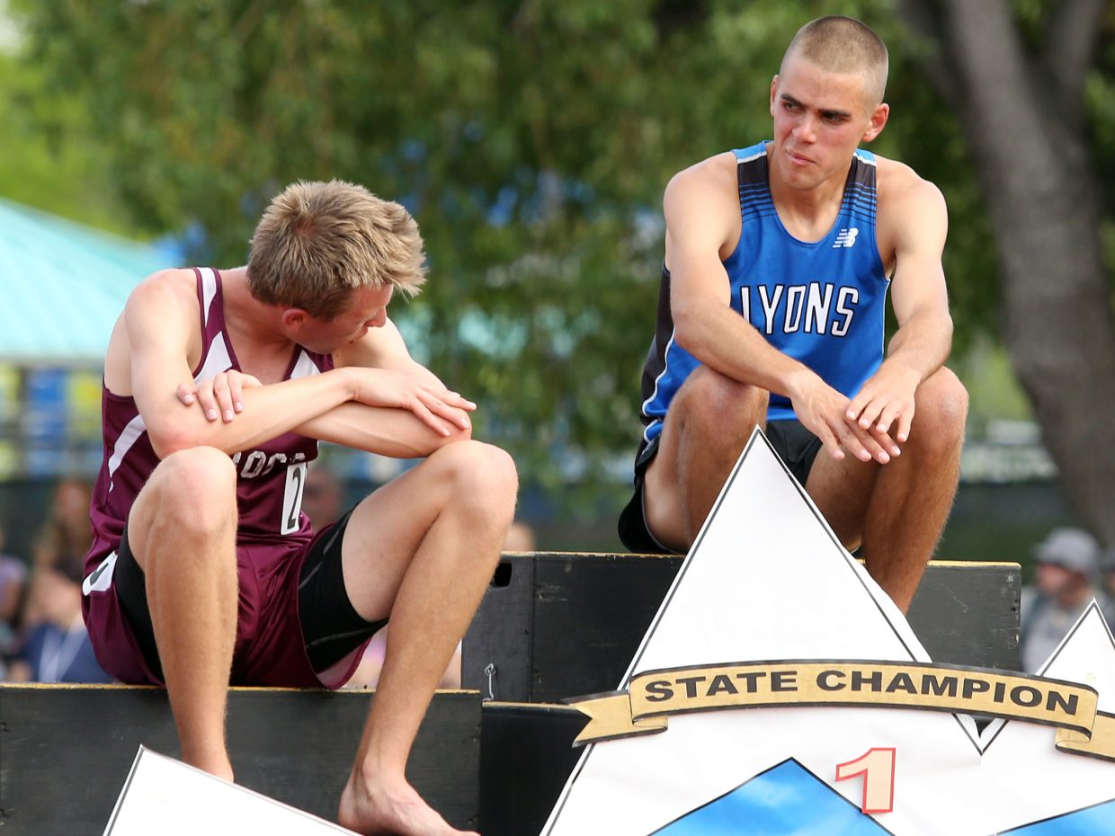 Soroco sophomore Ben Kelley, left, sits on the 2A boys 1,600-meter podium with Lyons runner Paul Roberts. Kelley finished second with a school record time, while Roberts broke the 2A meet record with a time of 2:19.54.