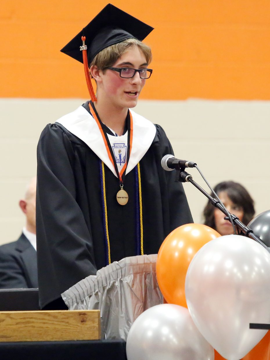 Hayden High School valedictorian Jof Deckler talks to his classmates during Sunday's graduation ceremony.