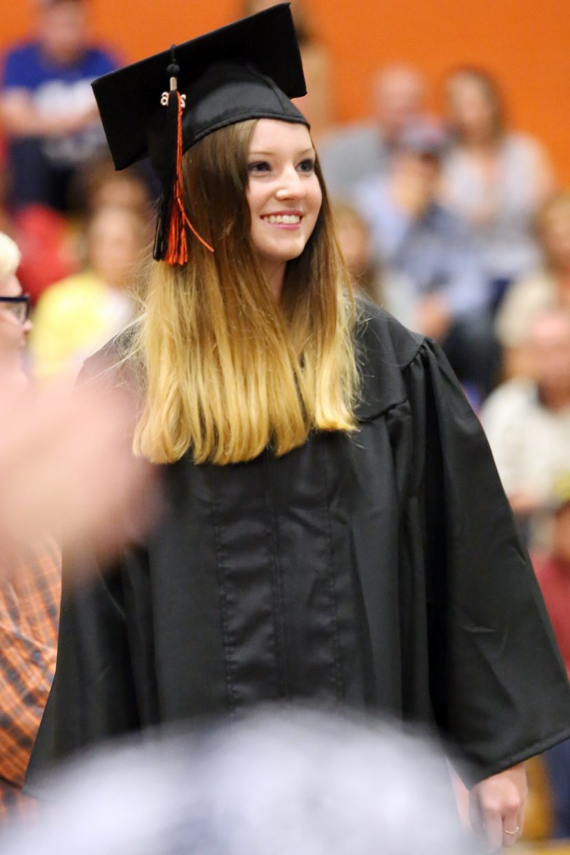 Lacey Warning prepares to walk across the stage Sunday during graduation at Hayden High School.