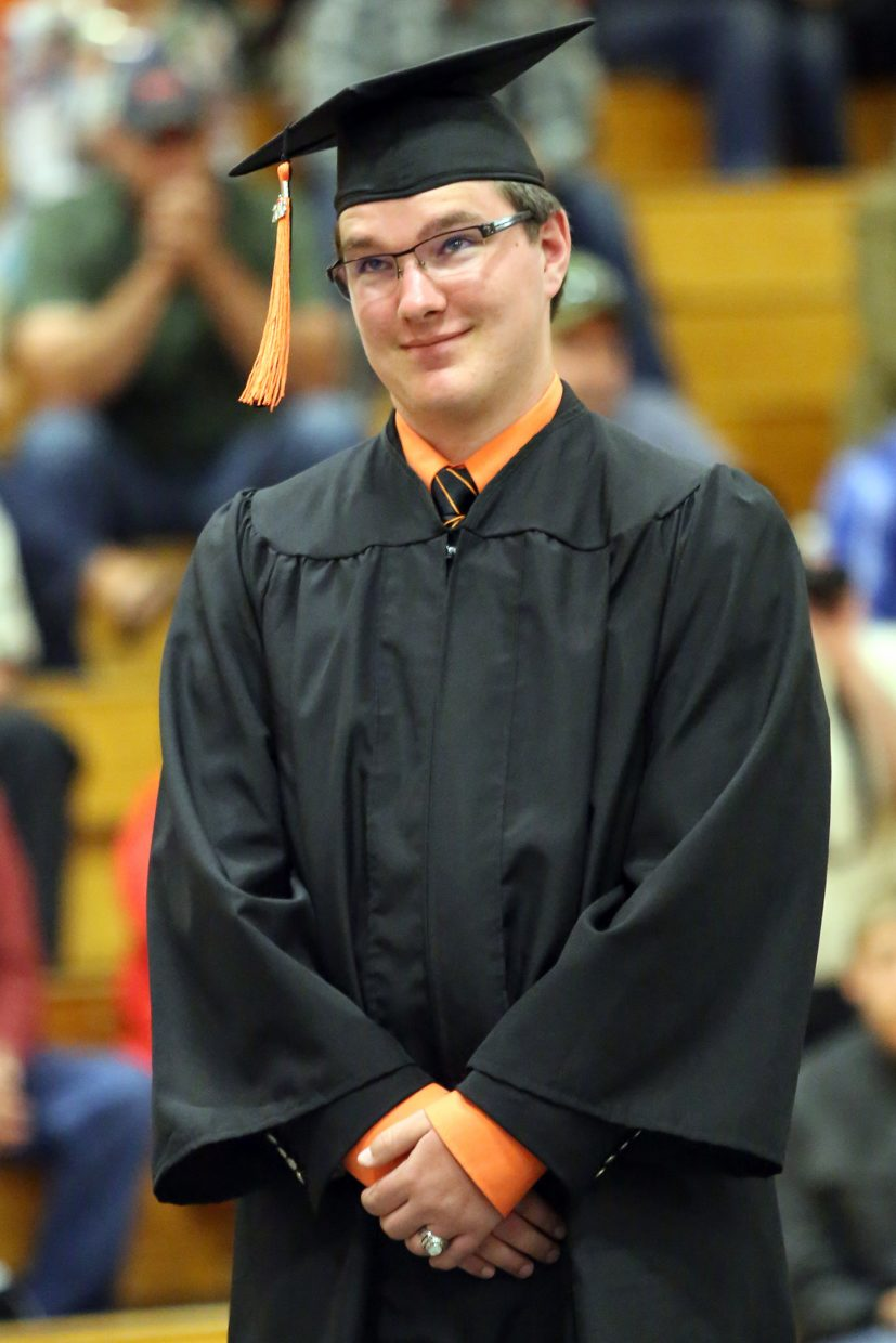 Jonathan Wright awaits his turn to walk across the stage Sunday during graduation at Hayden High School.