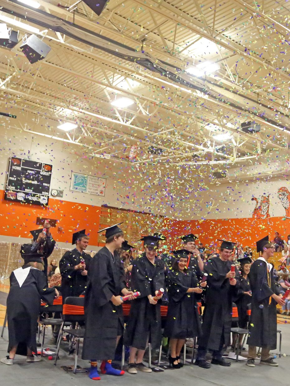 Confetti flies at the end of Sunday's 2016 graduation at Hayden High School.