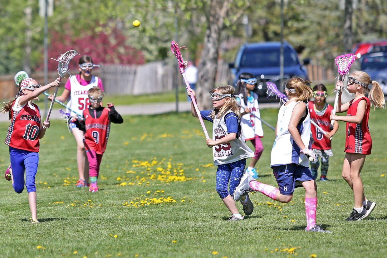 Elementary school students play lacrosse outside Steamboat Springs High School on Saturday. A total of 44 elementary and middle school girls, including 10 from out of town, competed in the 7v7 Memorial Weekend games. For many of the younger players, it was their first time playing with officials. The Steamboat Girls Lacrosse organization is looking for coaches and players to help build the program. More information can be found at steamboatgirlslacrosse.org.