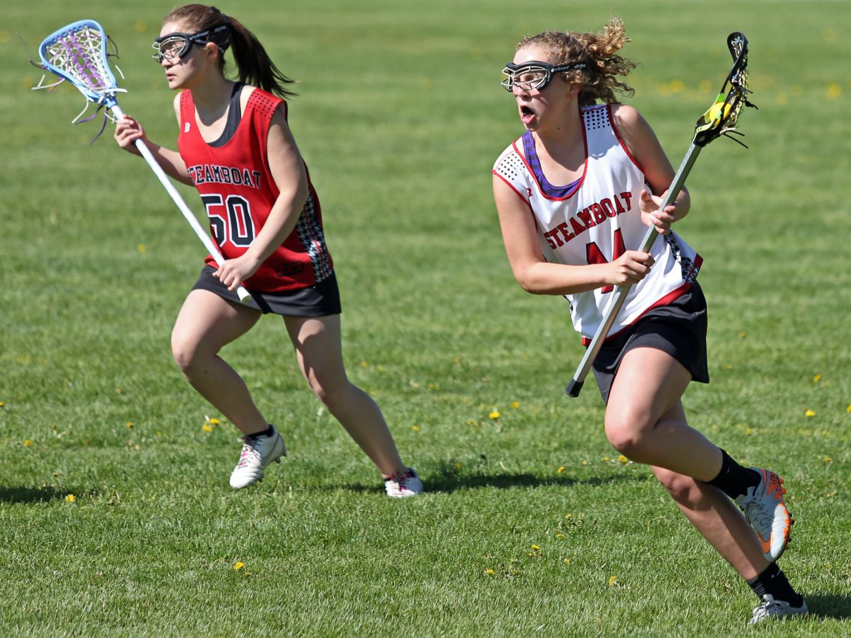 Steamboat Springs eighth-graders Riley Schott, right, and Cassidy Martinez compete in lacrosse outside Steamboat Springs High School on Saturday. Both girls plan to play lacrosse for the Sailors next spring.