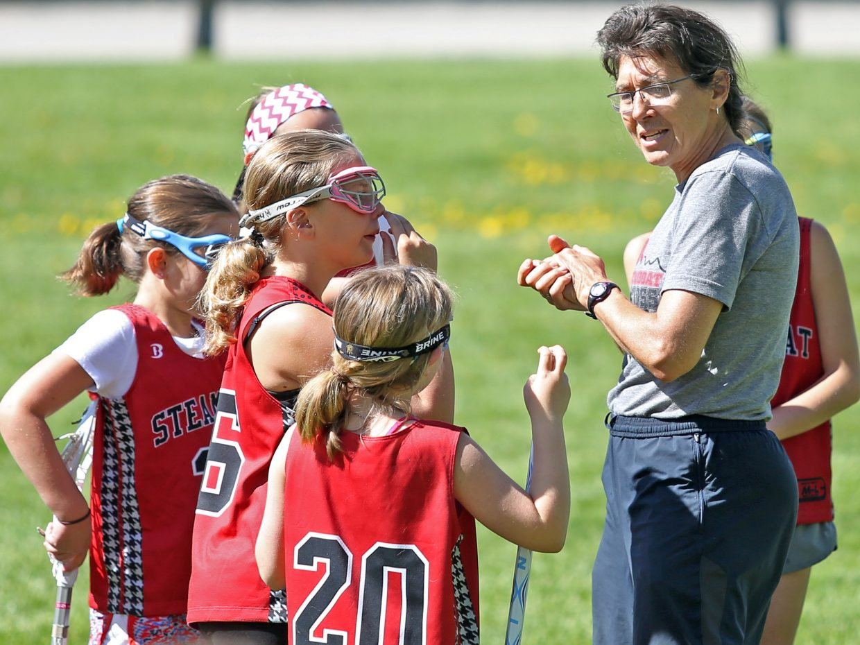 Steamboat Springs lacrosse coach Betsy Frick instructs a group of elementary school players prior to their game Saturday outside Steamboat Springs High School.