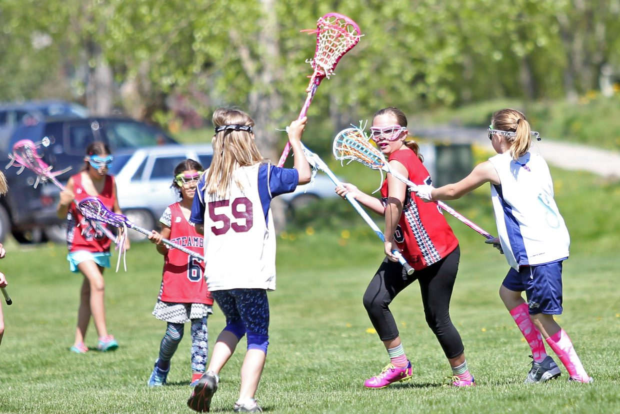 Elementary school students play lacrosse outside Steamboat Springs High School on Saturday. A total of 44 elementary and middle school girls, including 10 from out of town, competed in the 7v7 Memorial Weekend games.