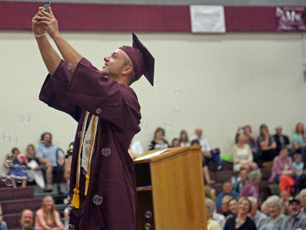 Soroco High School senior Storm Veilleux stops for a selfie before receiving his diploma during Saturday's graduation ceremony in Oak Creek. Veilleux will attend Cedarville University in Ohio to study nursing.