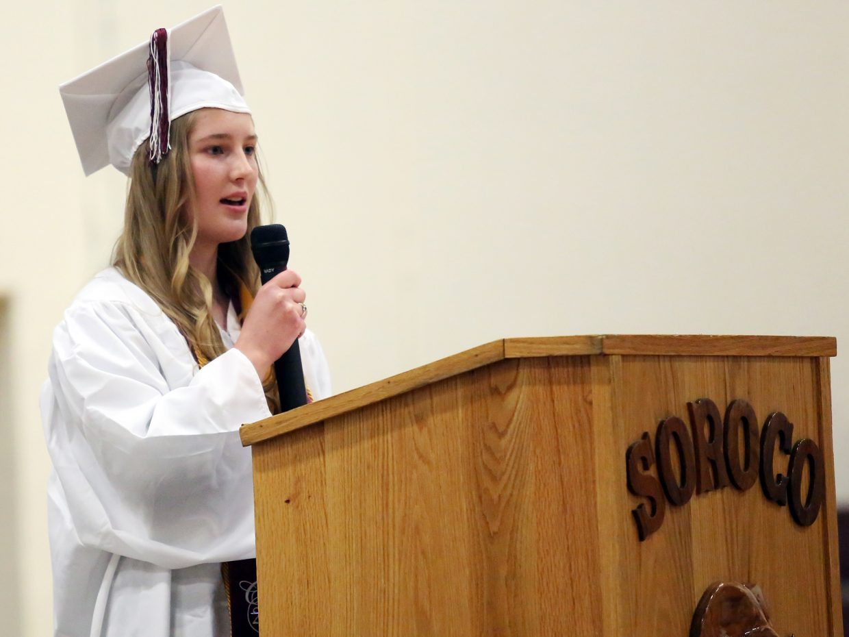 Soroco High School's 2016 valedictorian Cala McCollum speaks to her graduating class during Saturday's ceremony in Oak Creek. McCollum plans to attend Colorado Mesa University to study baking and pastry arts.