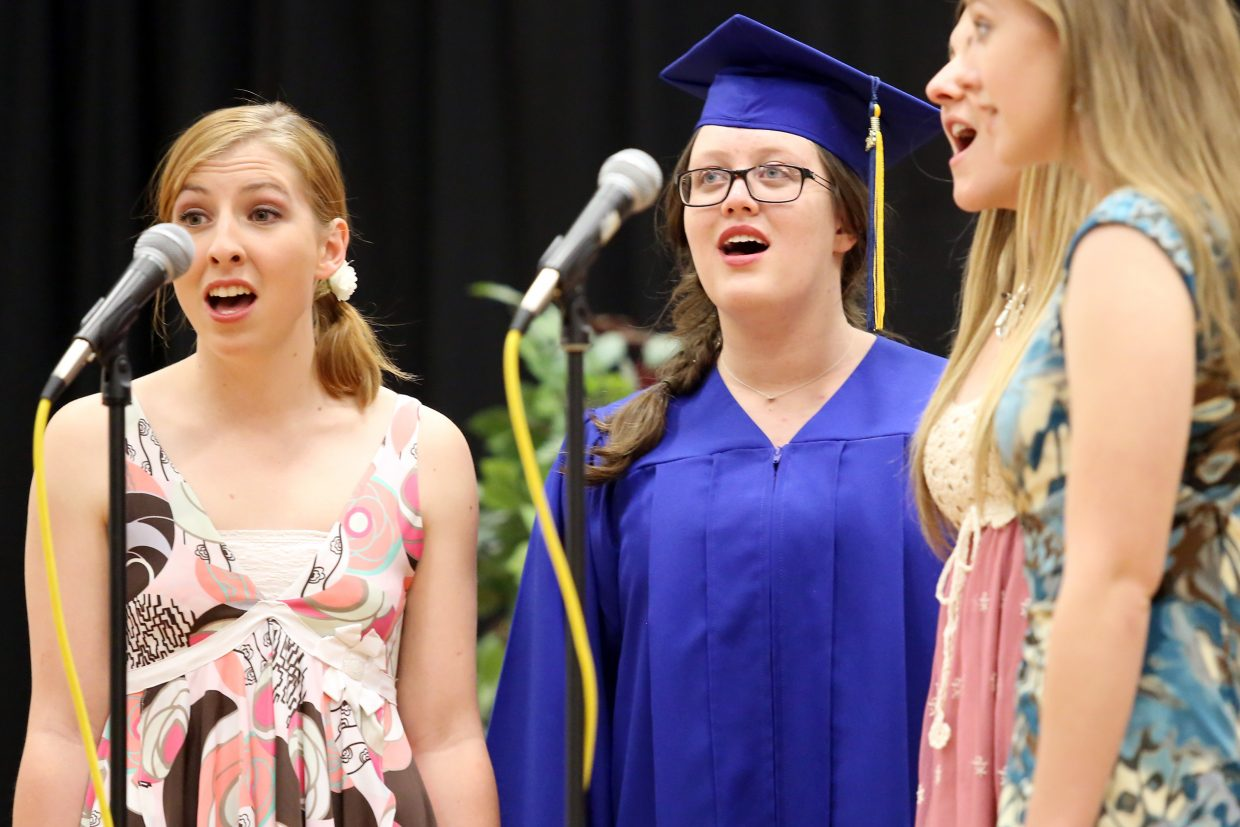 2016 Heritage Christian School graduate Jacqueline Poirot, center, sings alongside friends Andy Houston, left, Paige Eivins and Andrea Clark during Sunday's ceremony.