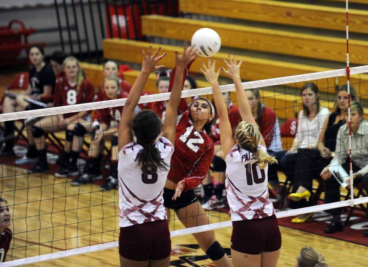 Maddie Labor smashes home one of her team-high seven kills Friday night. Steamboat's 3-0 win was its second sweep of the week.