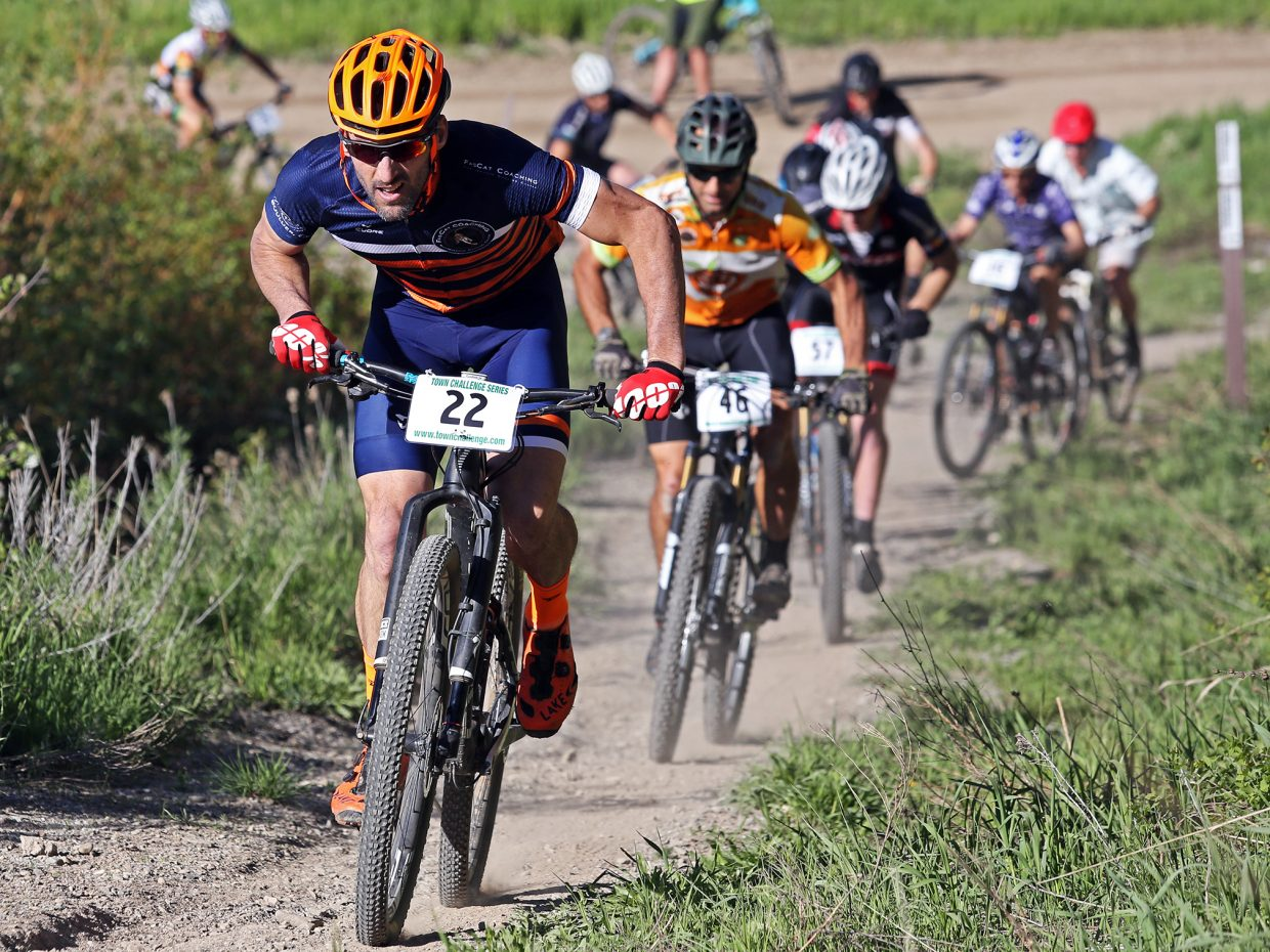 Jeremy MacGray leads the charge up the first major hill in the men's expert 35 to 49 age division of Wednesday's Town Challenge race at Marabou Ranch. MacGray would win the race.