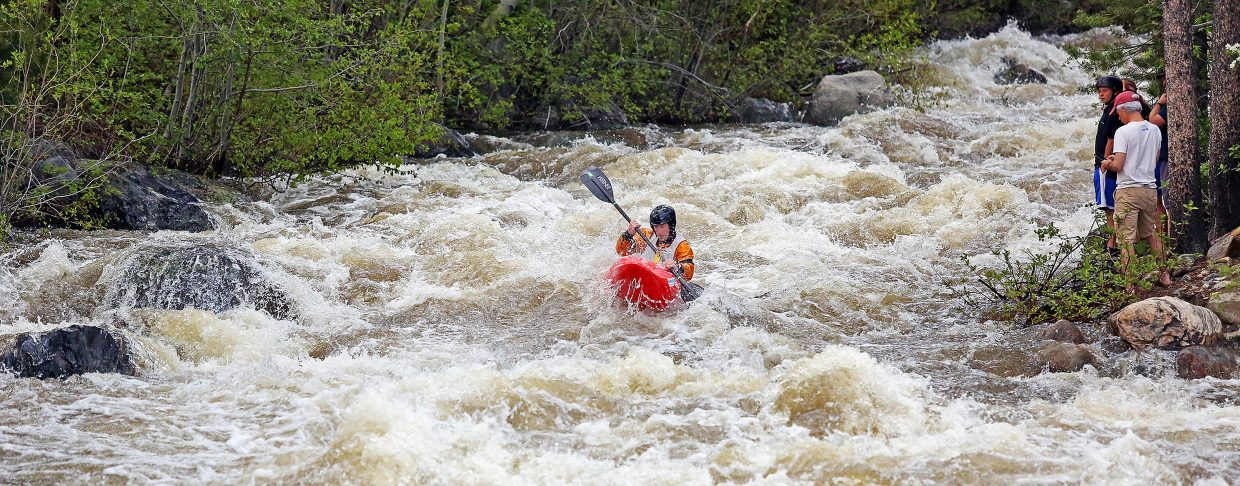 A kayaker competes Friday during the Fish Creek Race, part of the weekend's Yampa River Festival activities.