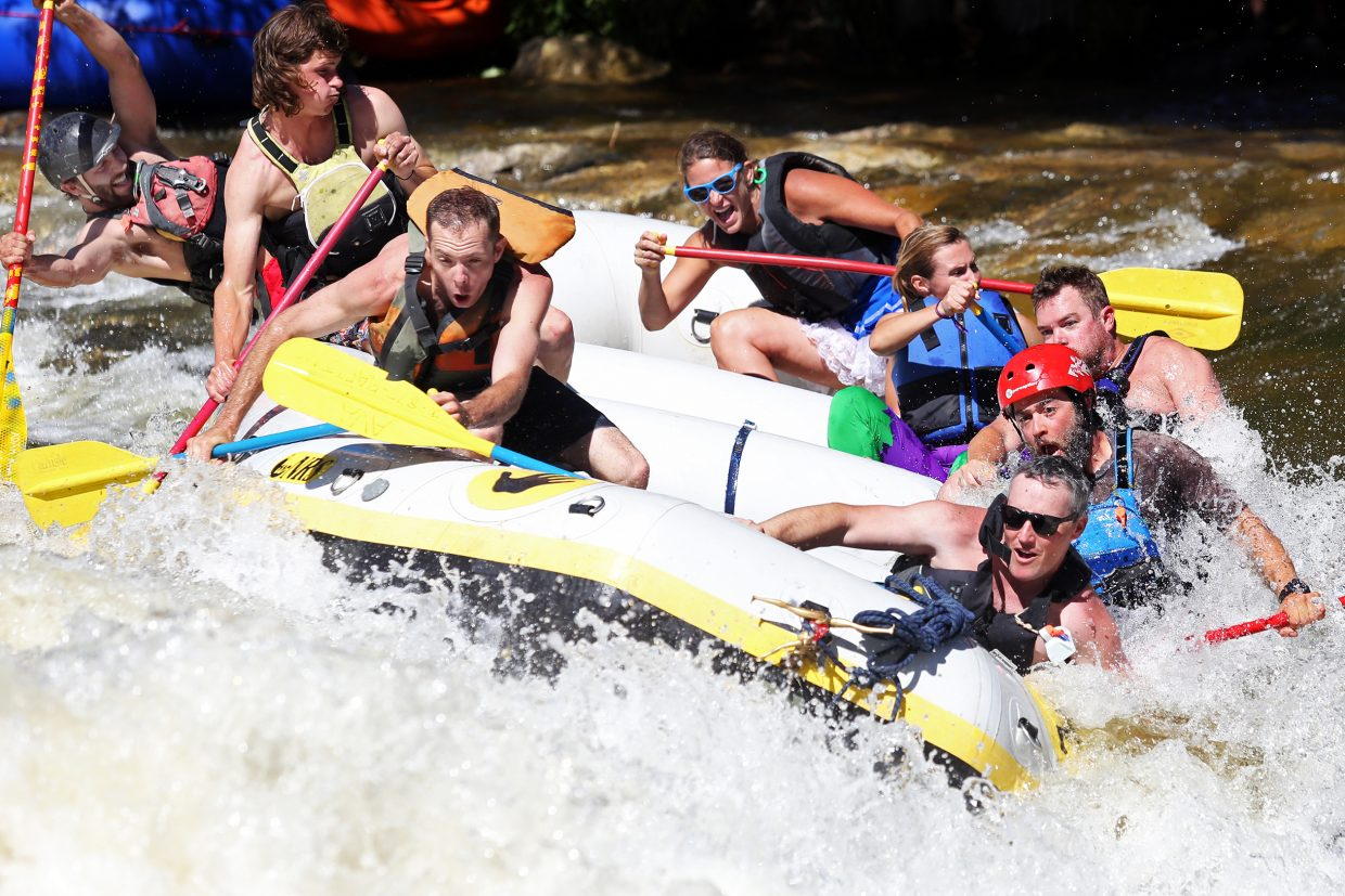 Rafters attempt to wrangle Charlie's Hole Saturday during the 36th annual Yampa River Festival in Steamboat Springs. There is one final event on Sunday, the 11:30 a.m. kayak slalom race at Dr. Rich Weiss Park.