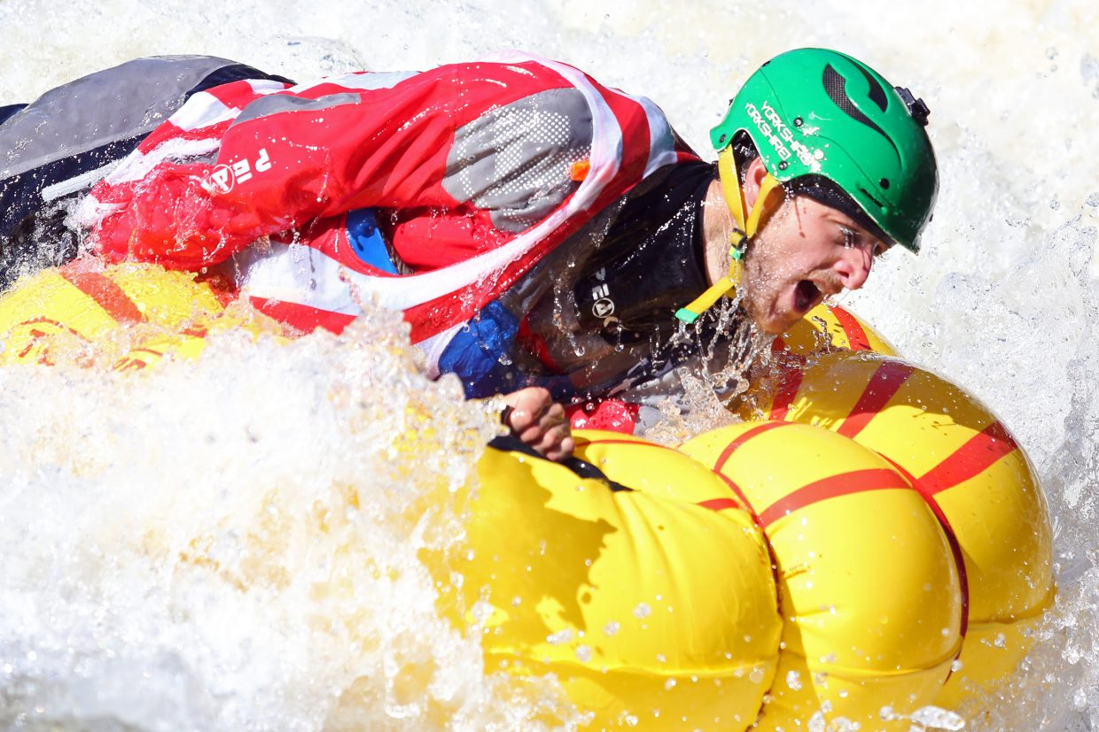England's Joe Morley competes in the tube rodeo contest Saturday during the 36th annual Yampa River Festival. Morley, who also won Friday's Fish Creek kayak race, won the event.