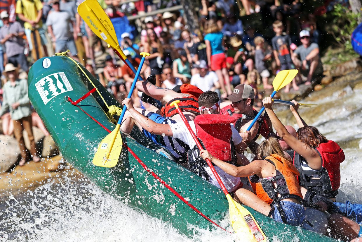 Rafters barely maintain an upright position while going through Charlie's Hole during Saturday's Yampa River Festival.