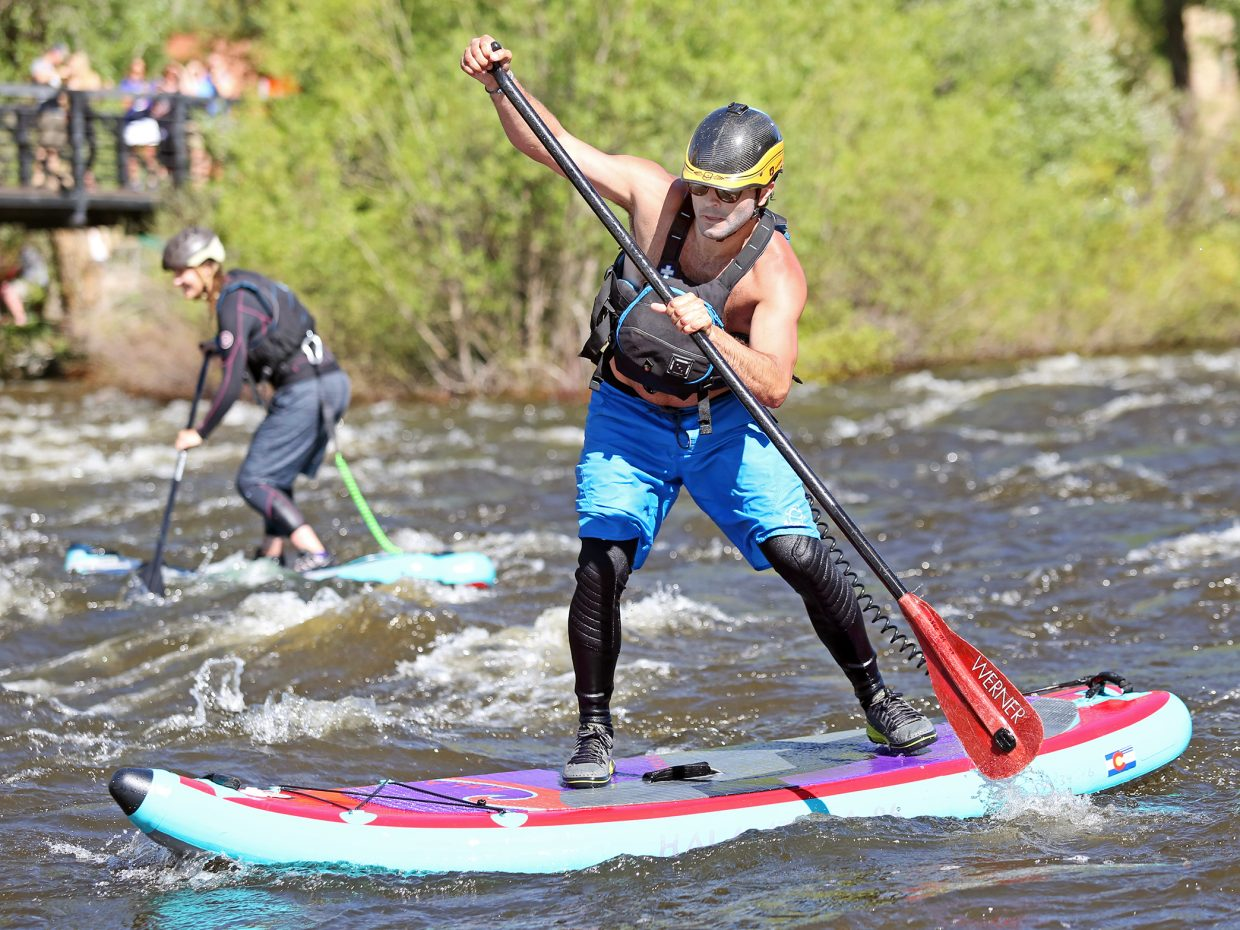 Stand up paddleboarders compete in the SUP Cup of Saturday's Yampa River Festival.