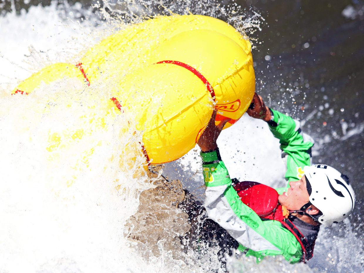 A tuber goes overboard during the tube rodeo portion of Saturday's Yampa River Festival.