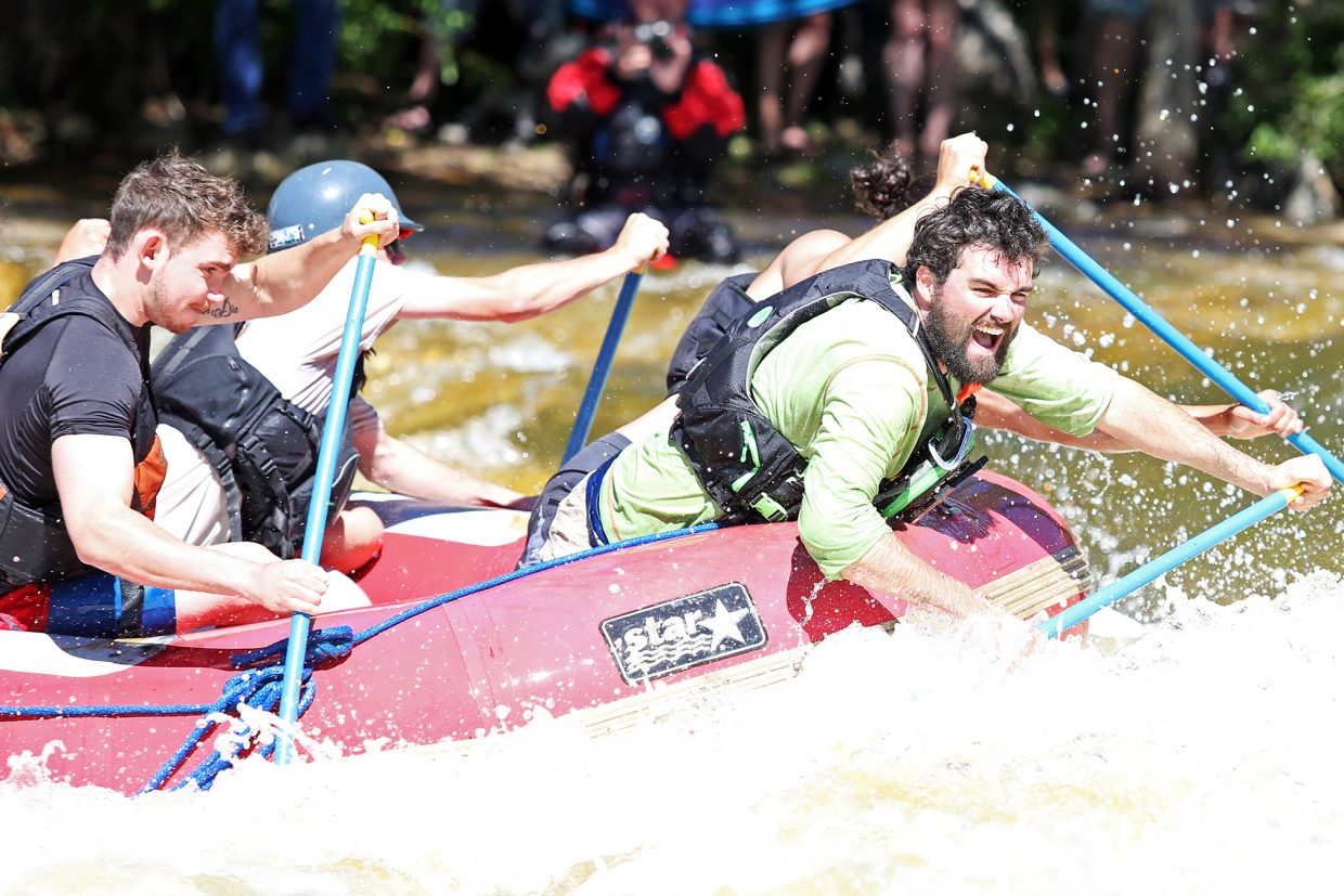 Rafters embrace the terror that can be Charlie's Hole during Saturday's Yampa River Festival.