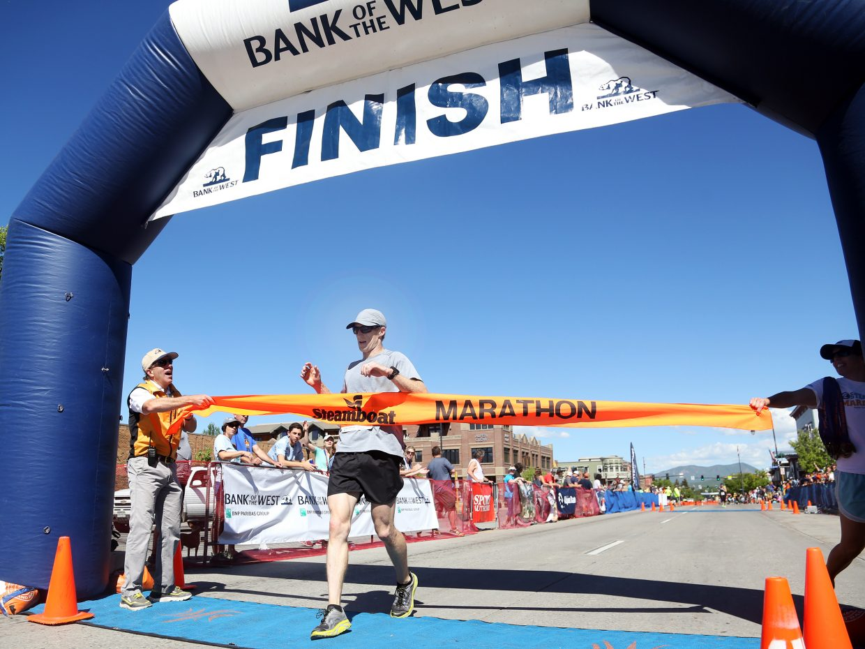 Littleton's Jim Rebenack is the first to cross the finish line in Sunday's 35th annual Steamboat Marathon.