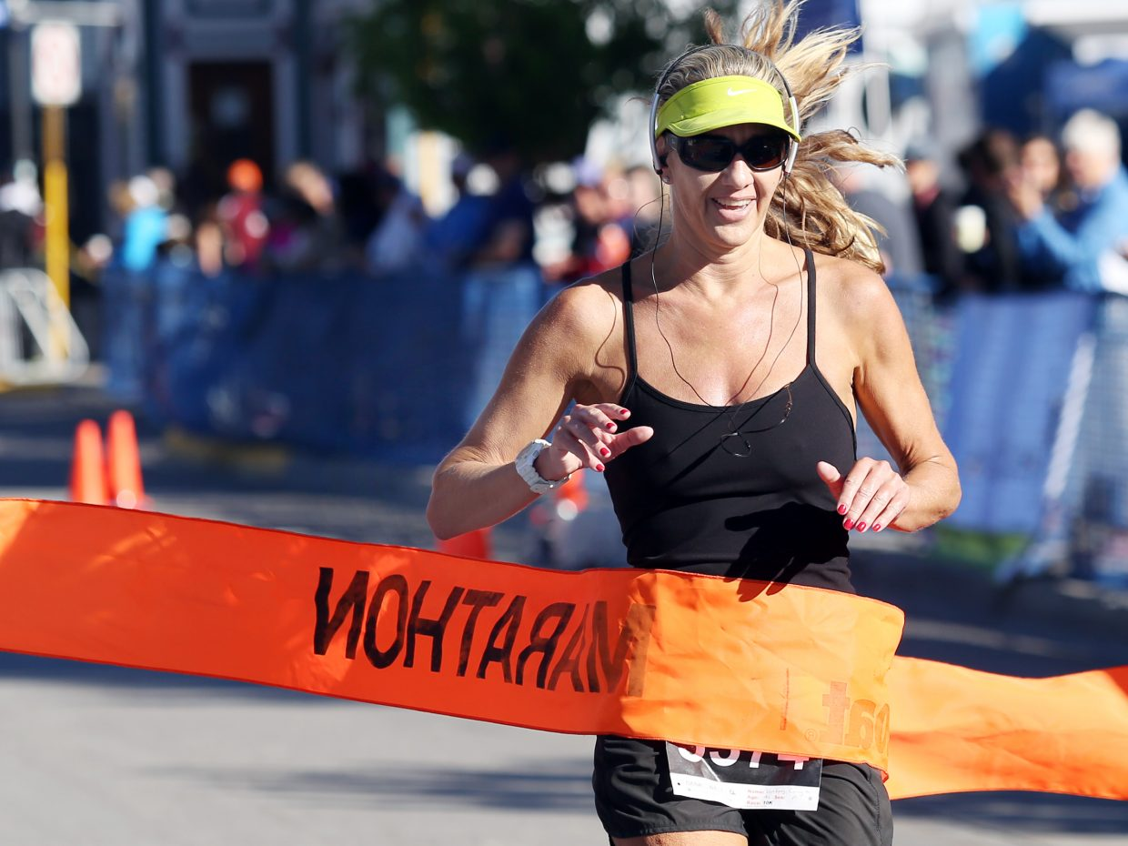 Santa Monica, California's Lindsay Covington is the first woman across the finish line of Sunday's Steamboat Marathon 10-kilometer race. She was ninth overall in the 10K with a time of 42:43.