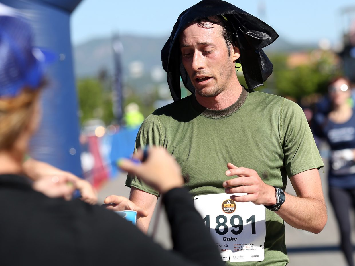 Steamboat Springs resident Gabe Small is exhausted after finishing Sunday's Steamboat Half Marathon. He took second in 1 hour, 16 minutes, 51 seconds.