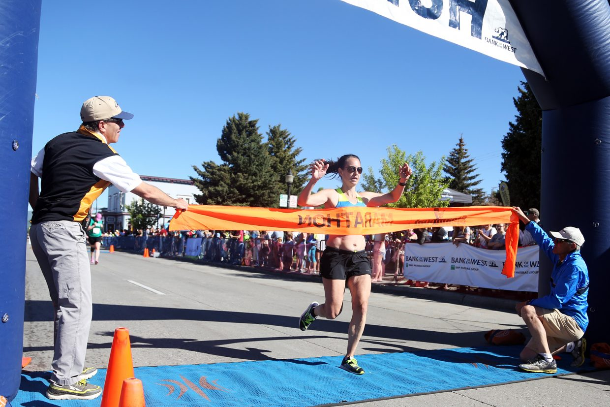 New York's Lesley Maio is the first woman to cross the finish line of Sunday's Steamboat Half Marathon.
