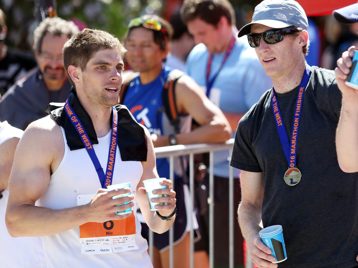 Littleton's Jim Rebenack, right, Sunday's Steamboat Marathon winner, chats with the runner-up finisher, Chicago's Nic Aubert, moments after the race.