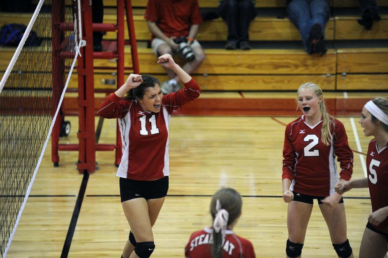 Maddie Robertson, No. 11, celebrates a critical kill near the end of Steamboat's Game 1 win against Delta. The Sailors went on to win the match, 3-1.