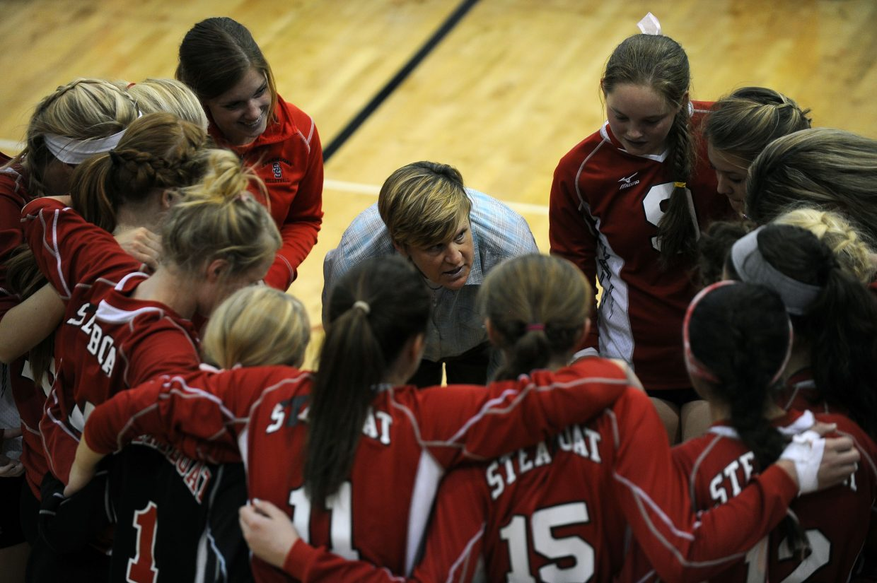 Sailors volleyball coach Wendy Hall talks to her squad after winning Game 1, 25-19, en route to a 3-1 victory against Delta.
