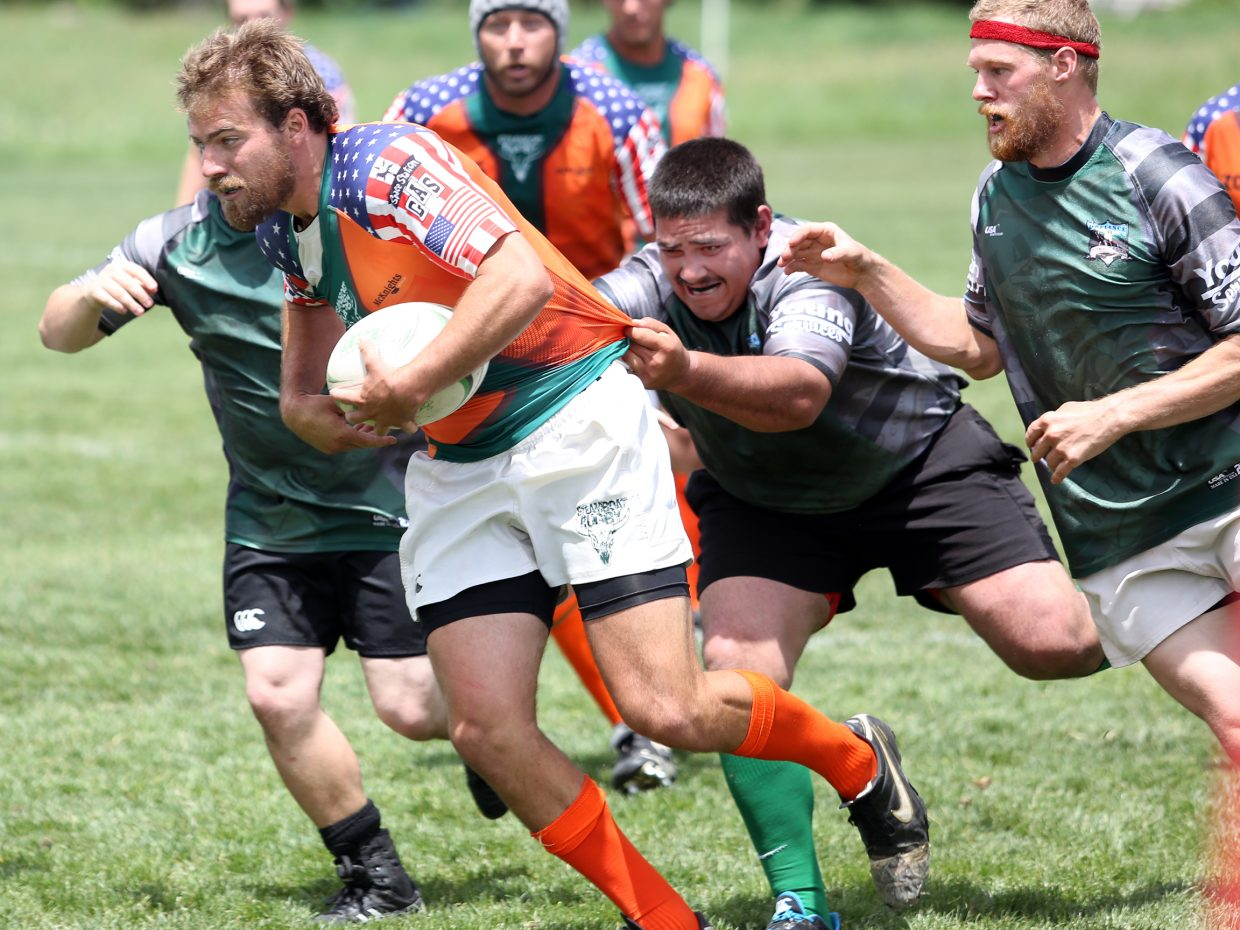 The Steamboat Springs Rugby Football Club, dressed in orange, competes against Glenwood Springs on Saturday at Whistler Field in Steamboat.