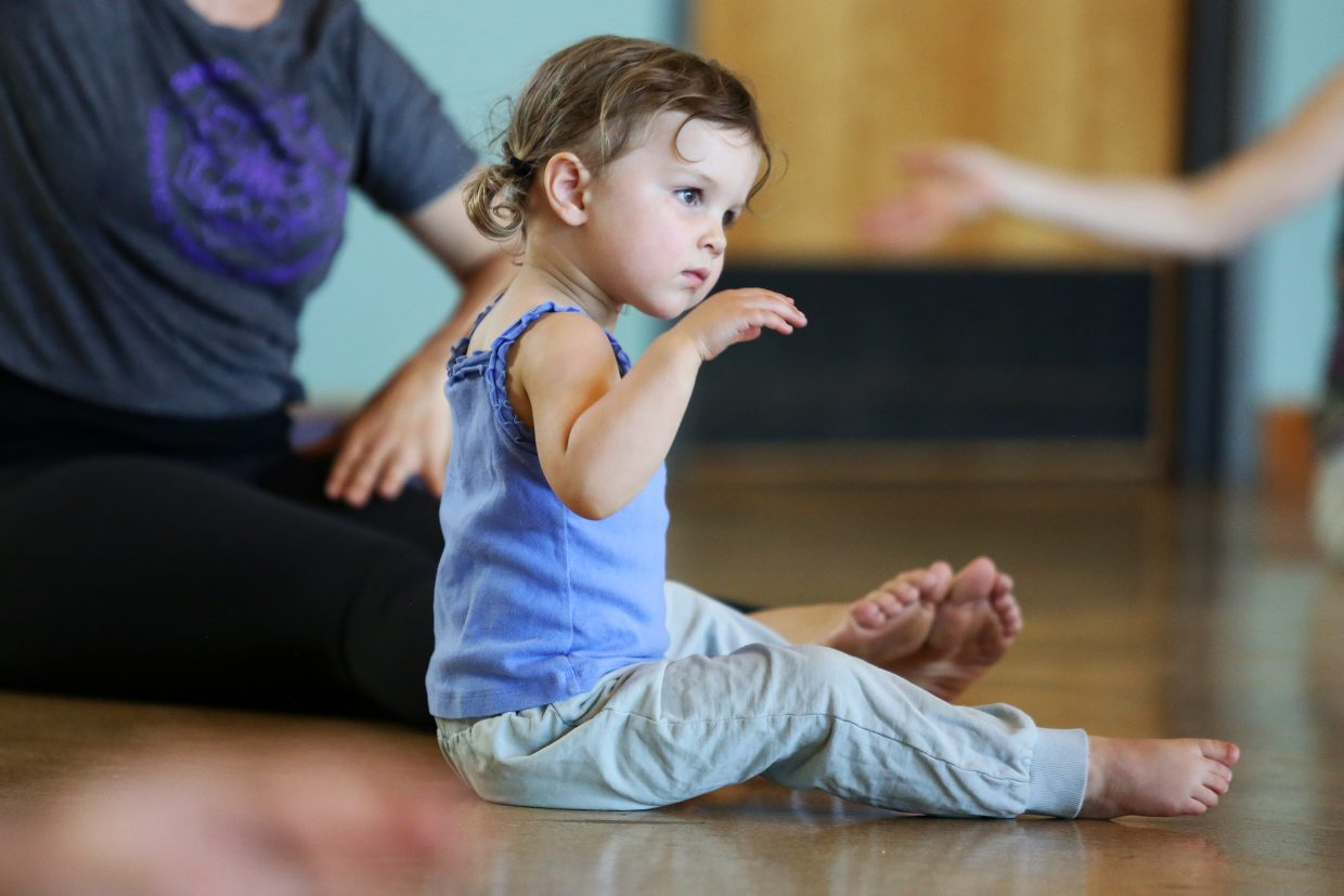 Steamboat Springs resident Lola Jespersen, 2, attempts to mimic the warmup movements Sunday during Mecca Madyun's West Africa dance class, which was held at Bud Werner Memorial Library. Madyun will be one of the teachers at this year's Steamboat Movement Fest, which runs Aug. 11 through 14.