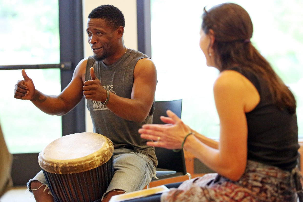 King Salim Ajanku gives his approval during Sunday's West Africa drum class, held at Bud Werner Memorial Library. Ajanku, a Denver-based musician, will be one of the instructors at Steamboat Movement Fest in August.