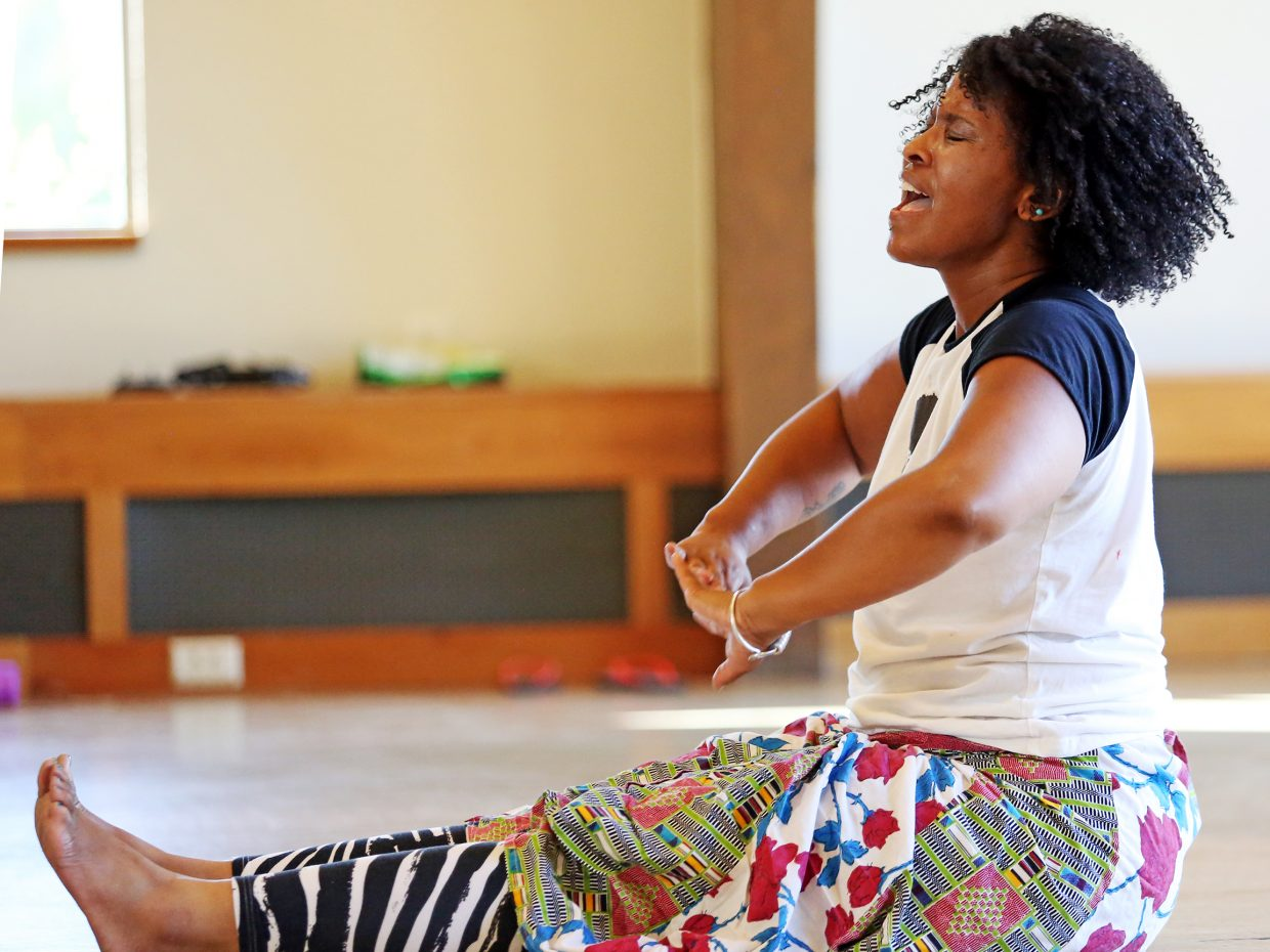 Instructor Mecca Madyun leads warmups during her West Africa dance class Sunday at Bud Werner Memorial Library.