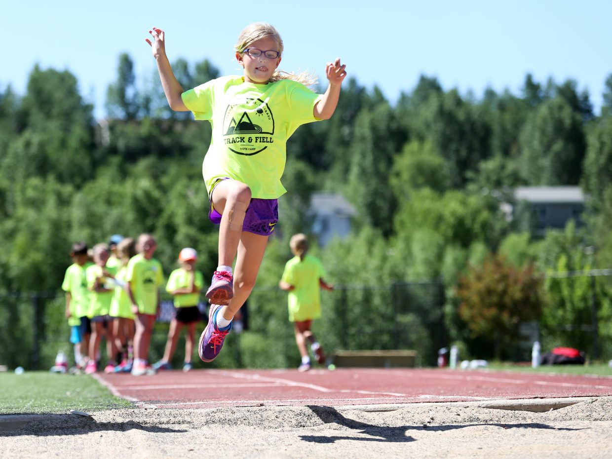 Sydney Langell competes in the long jump Friday during a mock track meet, the finale of the weeklong Steamboat Springs Youth Track and Field Camp at Gardner Field.