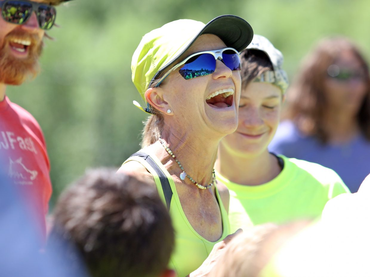 Steamboat Springs High School track and field coach Lisa Renee Tumminello laughs Friday, the final day of the weeklong youth track and field camp at Gardner Field.