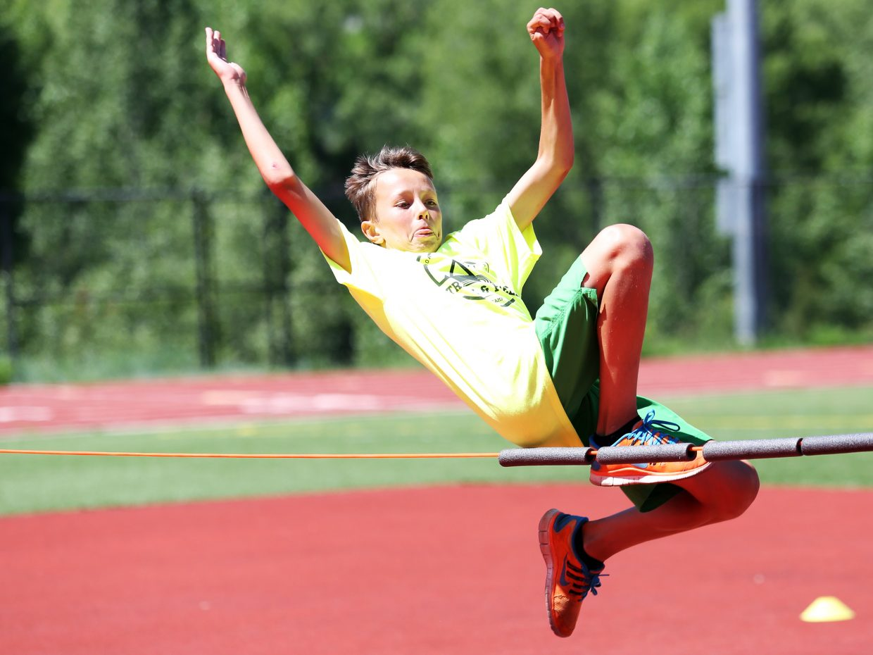 Owen Petersen competes in the high jump during Friday's Steamboat Springs youth track and field camp at Gardner Field.