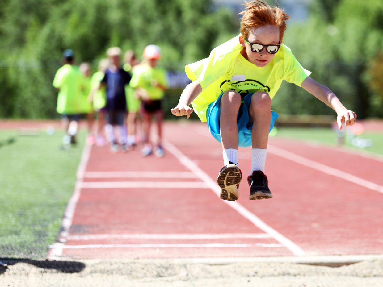 Luke Hammond-Furst competes in the long jump during Friday's Steamboat Springs youth track and field camp at Gardner Field.