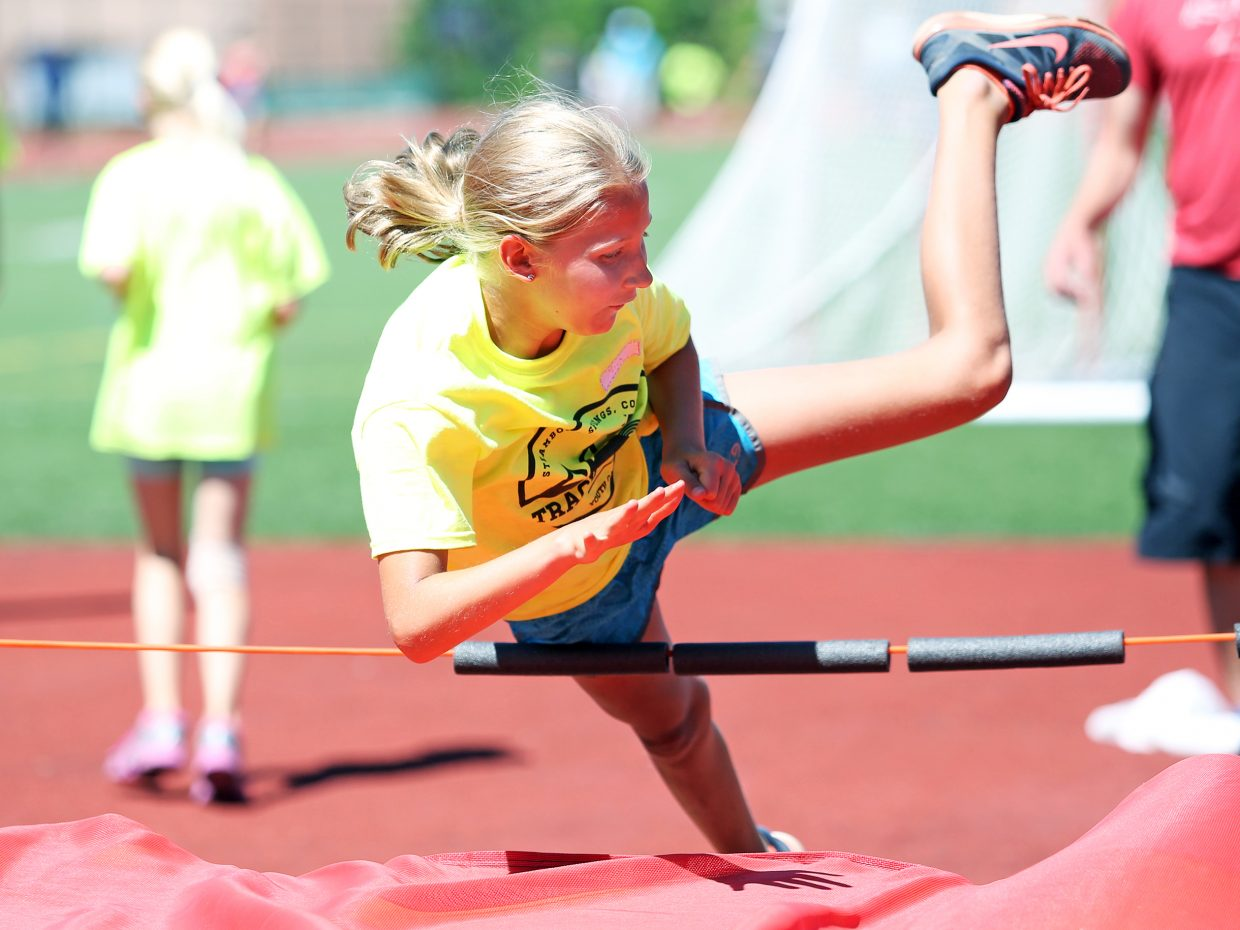 Mia McNamara competes in the high jump during Friday's Steamboat Springs youth track and field camp at Gardner Field.