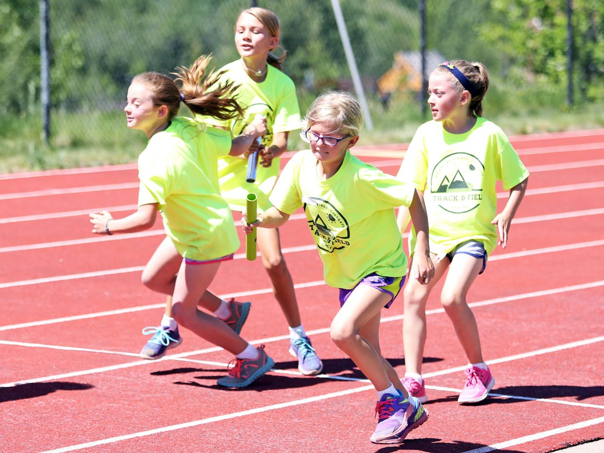 Children compete in a relay during Friday's Steamboat Springs youth track and field camp at Gardner Field.