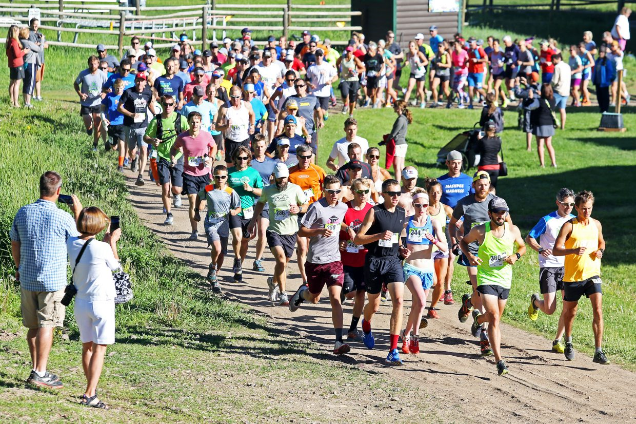 Runners take off from Olympian Hall for the start of Saturday's Howelsen Hill Trail Run in Steamboat Springs. Local athlete Devon Olson won the overall eight-mile race.
