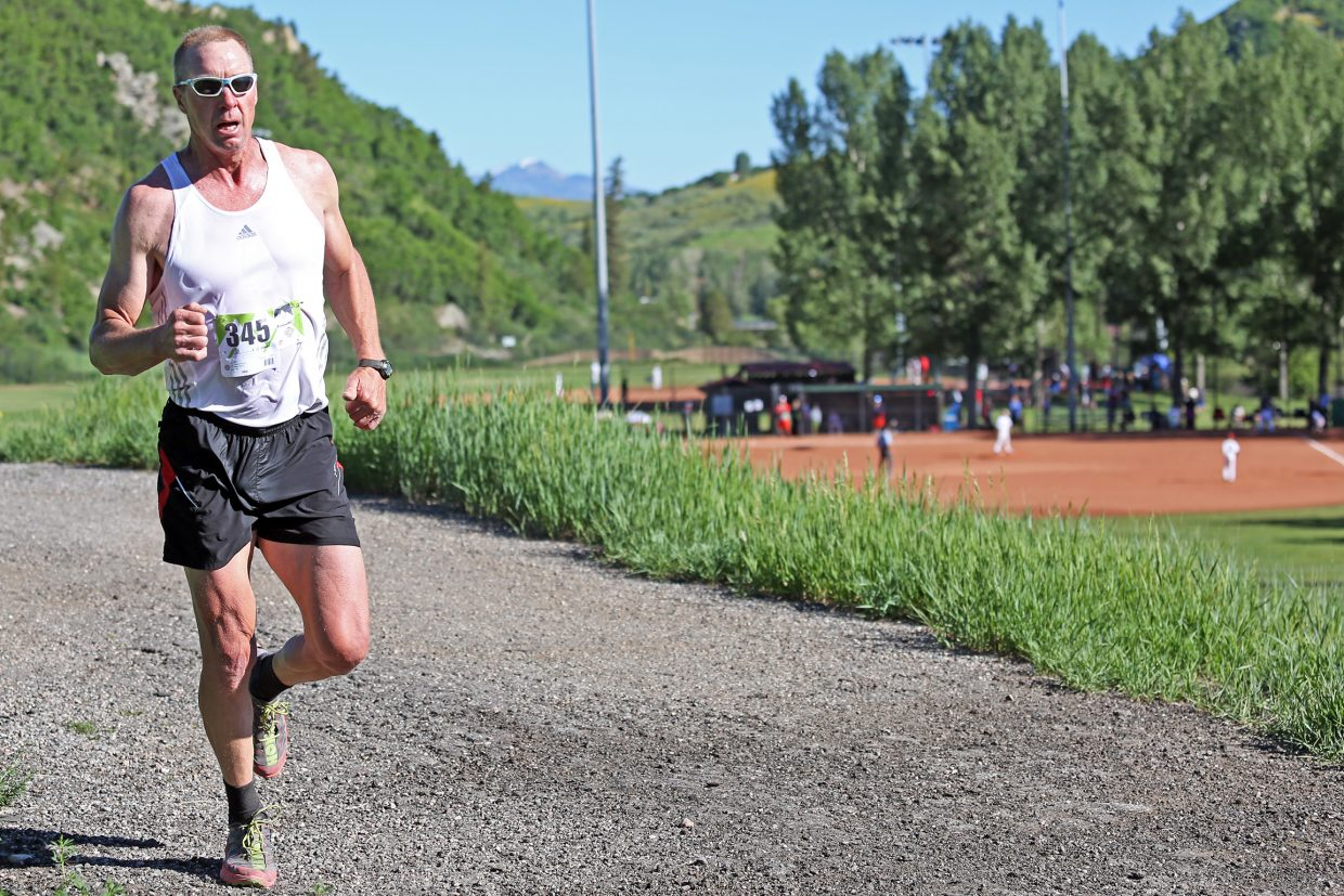 A runner competes in Saturday's Howelsen Hill Trail Run.