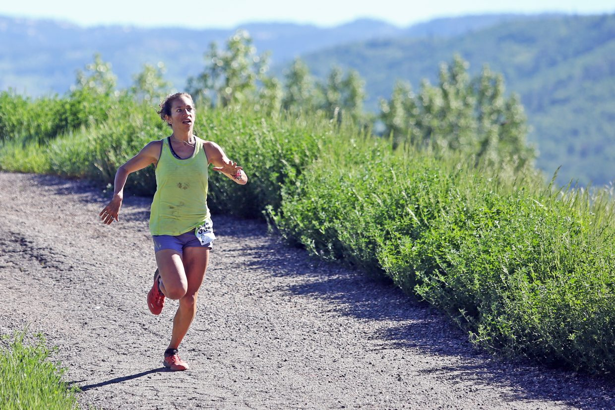 Steamboat Springs runner Penelope Freedman eyes the finish of Saturday's Howelsen Hill Trail Run. Freedman, last year's Running Series champion, was the top female in the eight-mile race.