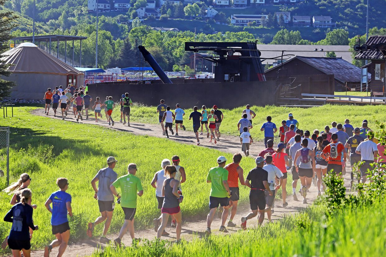 Runners take off from the start of Saturday's Howelsen Hill Trail Run, which featured a four-mile and eight-mile race.
