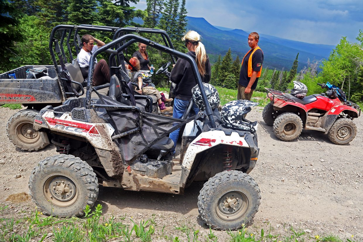 Zac Riley, an ATV guide with the Hahn's Peak Roadhouse in North Routt wearing the orange vest, talks to a few clients during a two-hour trip around Hahn's Peak on Thursday.