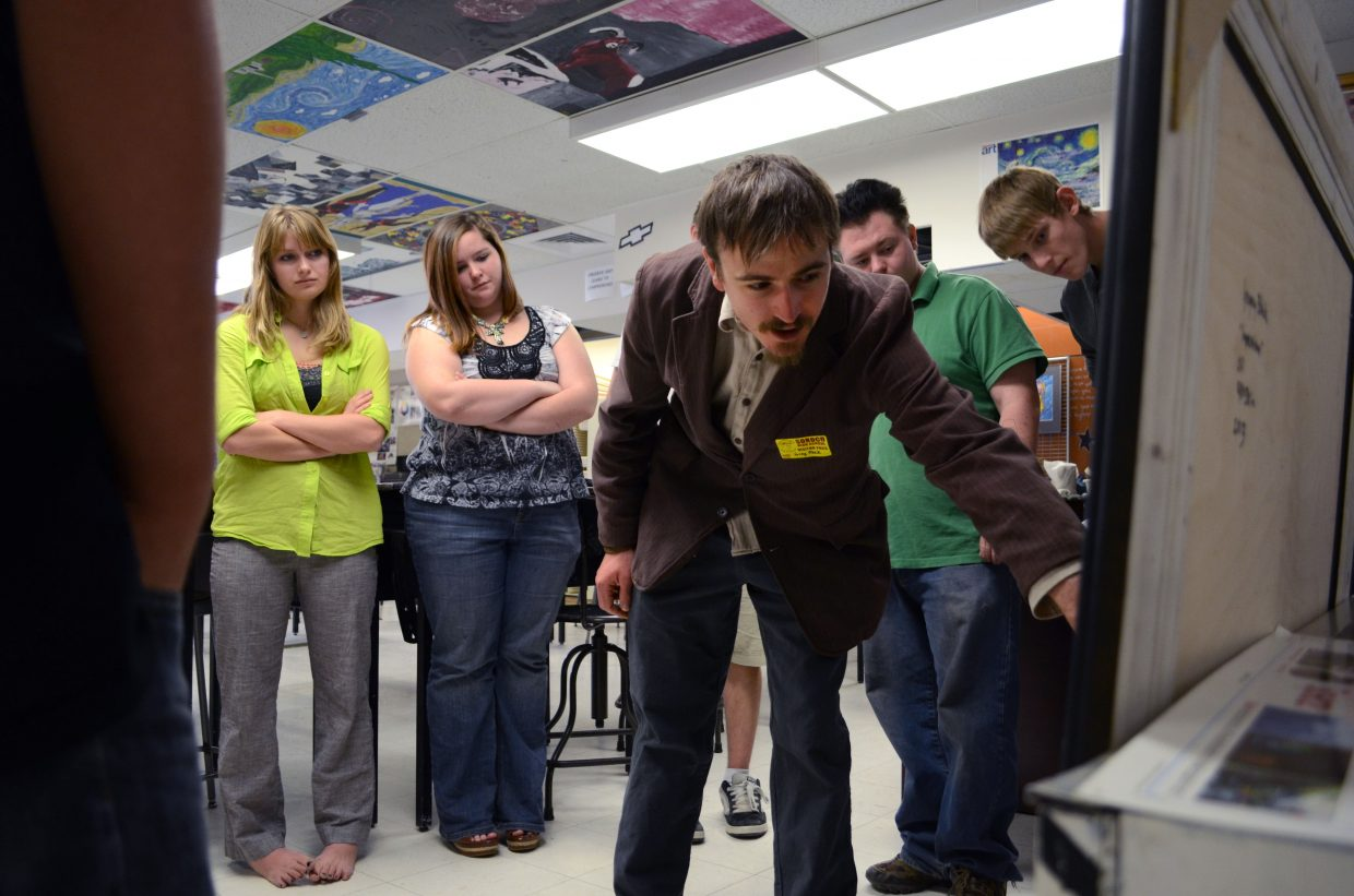 Guest presenter and Soroco High School alumnus Greg Block shows some of his artwork to the students sitting in on his presentation during the school's College Career Day on Thursday.