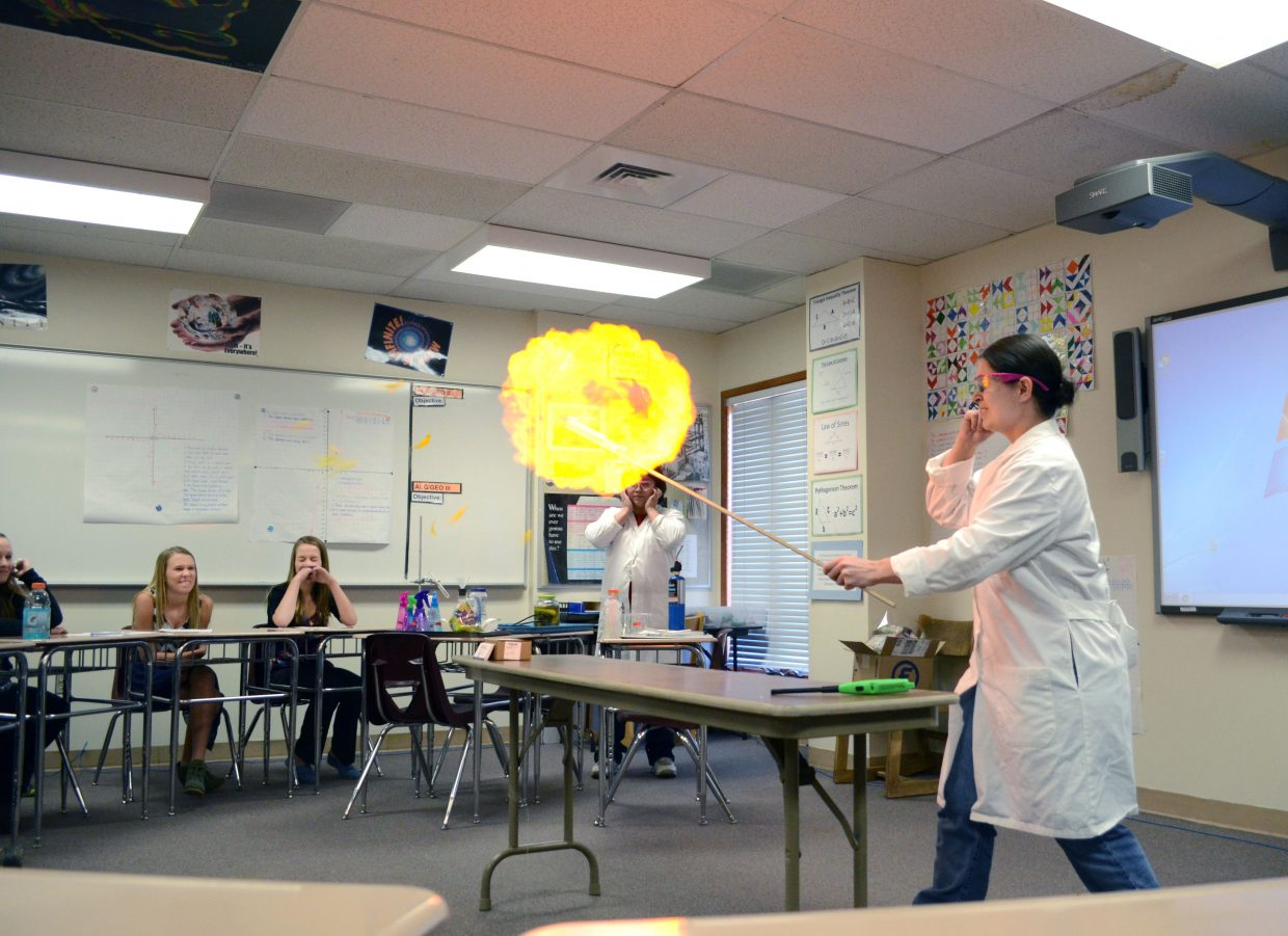 Scientist Liz Johnson woke up the room with her chemistry exercise Thursday, blowing up balloons with various gases, including hydrogen.