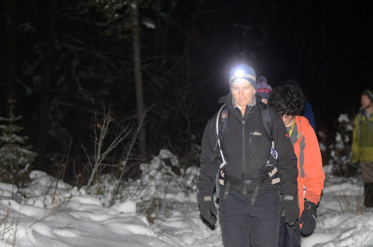 Yampatika naturalist Karen Vail leads a group of eight along the Skyline Trail on Sunday evening. The snow hike tour marked the tail end of the nonprofit's 20th anniversary celebration.