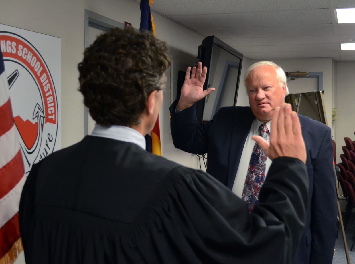 Steamboat Springs Board of Education member Roger Good takes his oath of office in front of Judge Paul Sachs in 2013.