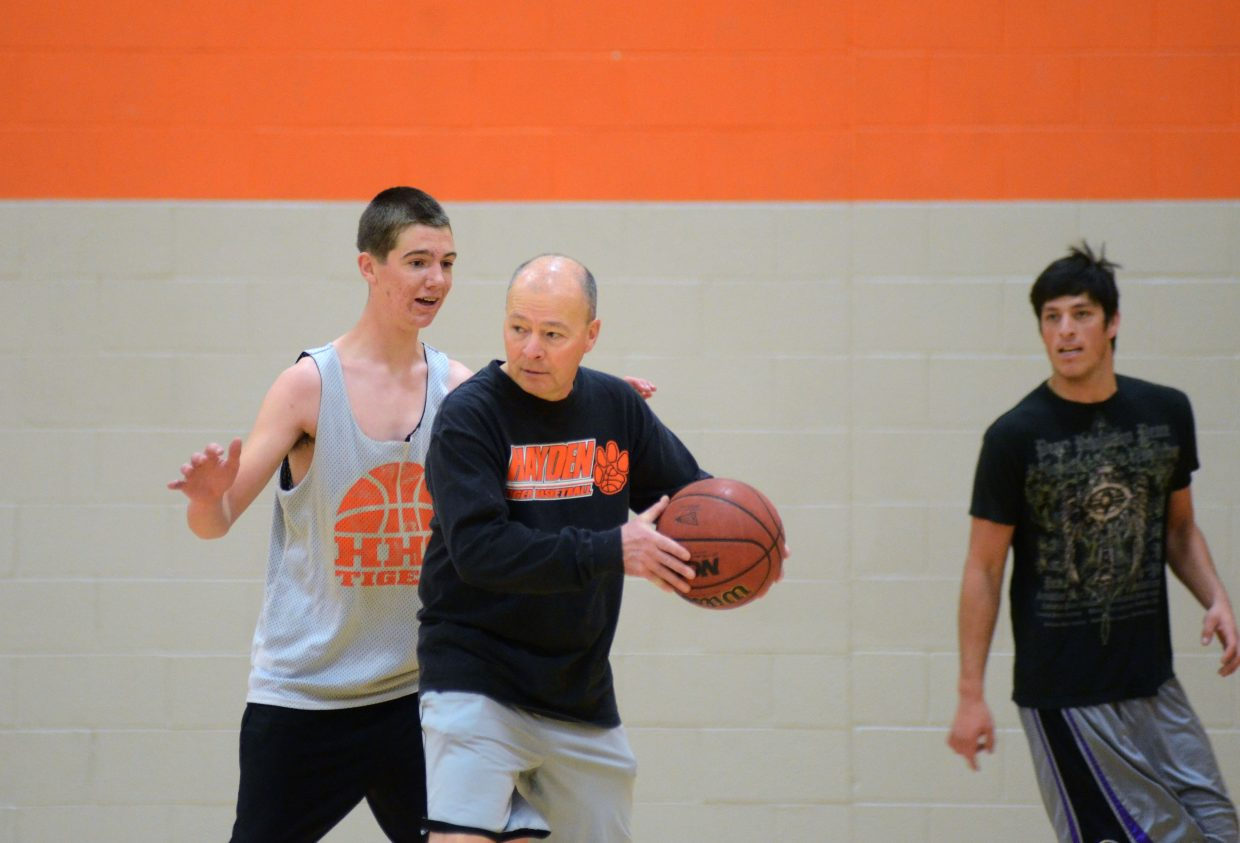 Hayden boys basketball coach Mike Luppes gets in on the scrimmage action during Saturday's practice, working some post moves on Thomas Rauch.
