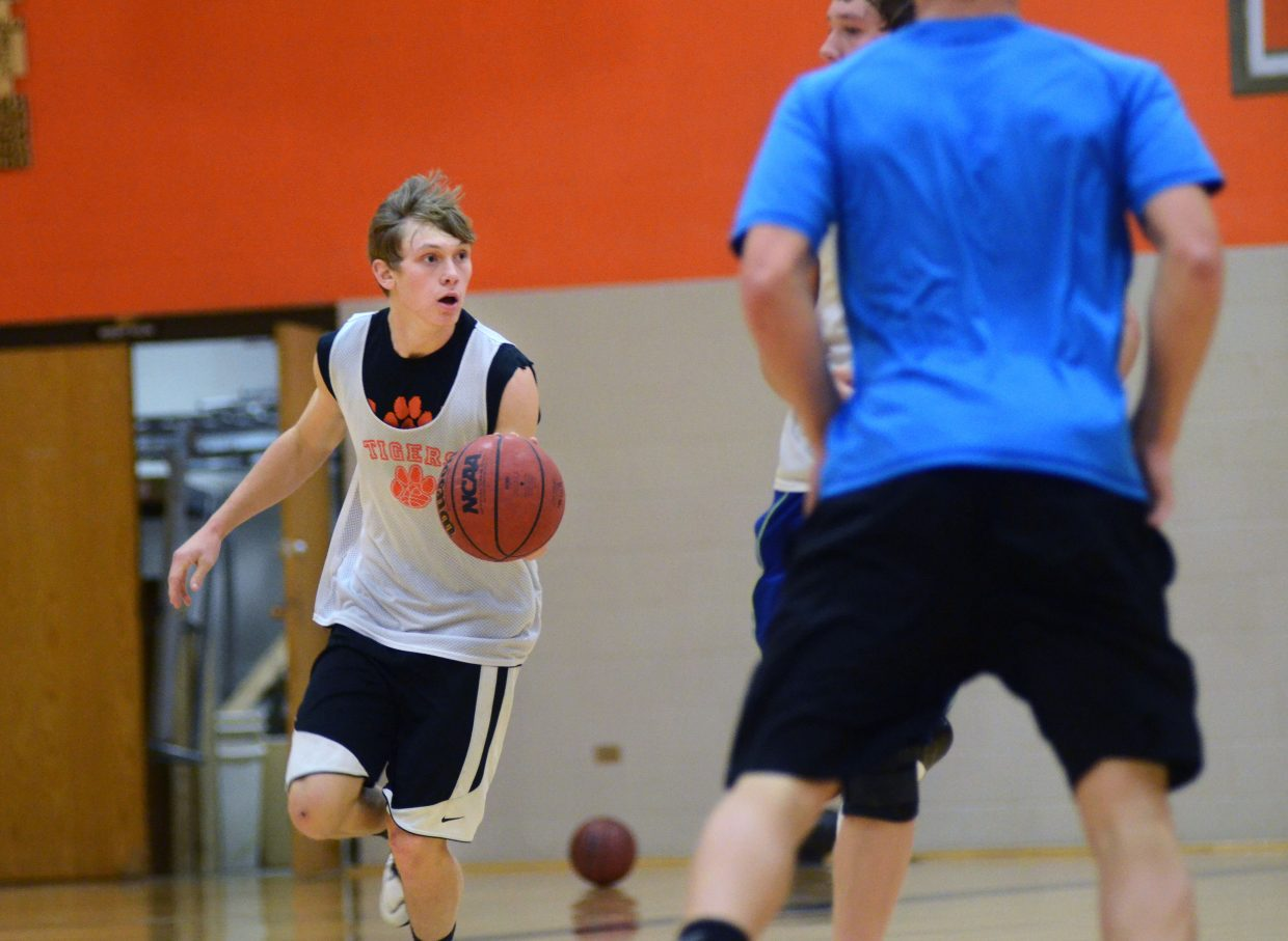 Senior Dan Engle pushes the ball up the floor during Saturday's practice. Engle said he has been taking over point guard duties with teammate Isaac Bridges out from injury.