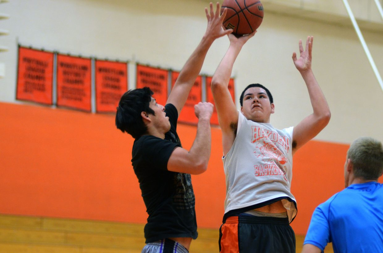 Hayden junior Carlos Valdez, right, goes up for a shot in practice Saturday against Jorge Valdez, a player from last year's 21-3 squad and currently one of the Tigers' volunteer coaches.